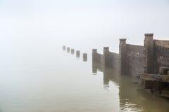 Groyne in the fog. Stock Photo