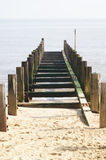 Groyne Leading into the Sea. A groyne (groin) sea defence projecting into the sea Royalty Free Stock Photo