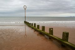 Groyne at Portobello beach on overcast day and low tide. stock photo
