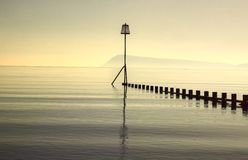 Groyne in sea mist Royalty Free Stock Photos