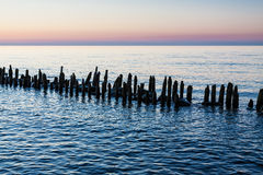 Groyne on shore Royalty Free Stock Photos