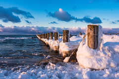 Groyne on shore of the Baltic Sea. In winter Stock Photos
