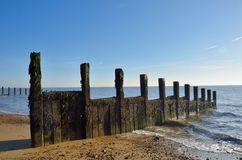 Groyne stretching into sea Stock Photography