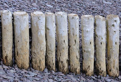 Groynes and pebbles Royalty Free Stock Images