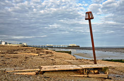 Groynes and post on Worthing beach. Groynes and a post on the shingle beach at Worthing, West Sussex, with the pier in the background Stock Photo