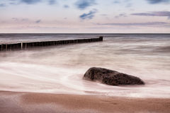 Groynes on shore of the Baltic Sea Royalty Free Stock Photo