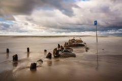Groynes on shore of the Baltic Sea Stock Photo