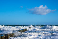 Groynes on shore of the Baltic Sea on a stormy day Royalty Free Stock Photo