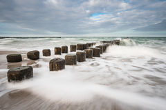 Groynes on shore of the Baltic Sea on a stormy day Stock Images