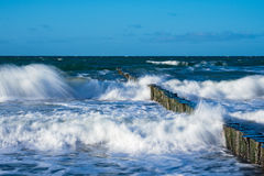 Groynes on shore of the Baltic Sea on a stormy day Royalty Free Stock Images