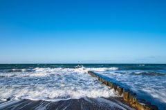 Groynes on shore of the Baltic Sea on a stormy day Royalty Free Stock Photography