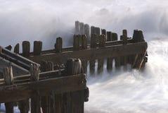 Groynes su una spiaggia Fotografia Stock