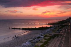 Groynes at sunset royalty free stock images