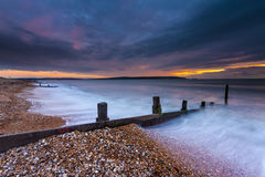Groynes at sunset in Milford-on-Sea Stock Photography