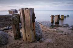 Groynes on Youghal stran Stock Images