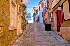 Groznjan cobbled street and old architecture view Stock Image