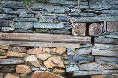 Grstary stone wall from rough stone Stock Photos