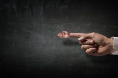 Grußgeste auf Zeigefinger Stockfoto