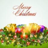 Grußkarte der frohen Weihnachten mit Geschenkkästen Lizenzfreie Stockfotografie