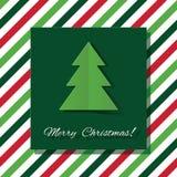 Grußkarte der frohen Weihnachten mit herausgeschnittenem Papierbaum auf abgestreiftem Hintergrund lizenzfreies stockbild