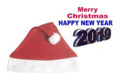 Grußkarte 2019 der frohen Weihnachten mit Weihnachtshut lizenzfreie stockfotos