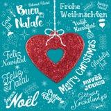Grußkarte der frohen Weihnachten von der Welt in den verschiedenen Sprachen Lizenzfreies Stockbild