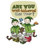 Grußkarte des guten Rutsch ins Neue Jahr und der frohen Weihnachten Weihnachtselfen packen Geschenkboxen aus und erhalten Geschen Stockbilder