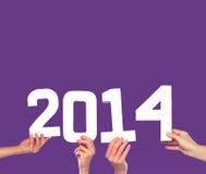 Grußkarte des neuen Jahres 2014 auf Purpur Stockbilder