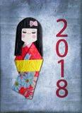 Grußkarte kokeshi Puppe des japanischen Papiers 2018 Stockbild