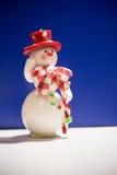 Grußkarte mit einem Schneemann Lizenzfreie Stockfotos