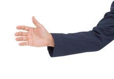 Gru a benna della mano dell'uomo di affari isolata su fondo bianco Fotografia Stock