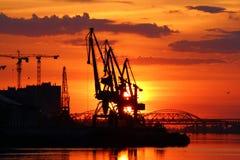 Gru del porto al tramonto Immagine Stock Libera da Diritti