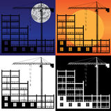 Gru di sollevamento e costruire in costruzione. Fotografia Stock