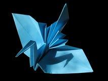 Gru festiva di Origami isolata sul nero Fotografia Stock