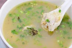 Gruau de riz avec des poissons Photo libre de droits