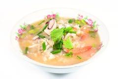 Gruau de riz avec du porc, la crevette et le squid, petit déjeuner thaïlandais image stock