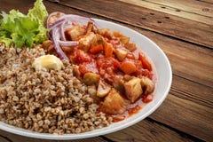 Gruau de sarrasin avec du porc et des légumes image stock