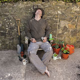 The Grubby, Snoozing, Happy Gardener. Royalty Free Stock Images