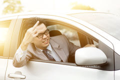 Grubiański kierowca pokazuje środkowego palec Obraz Stock