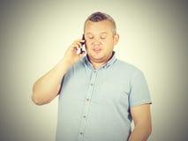Gruby biznesmen opowiada na telefonie Zdjęcie Royalty Free