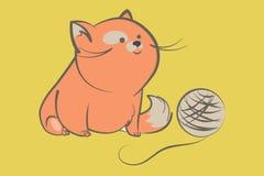 Gruby czerwony kot z piłką przędza Zdjęcia Stock
