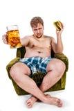 Gruby mężczyzna łasowania hamburger Zdjęcie Royalty Free