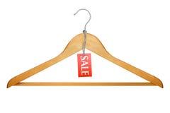 Gruccia per vestiti con l'etichetta di vendita Immagini Stock