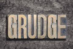 Free Grudge Word Burned Wood Royalty Free Stock Photo - 104431985