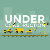 Grue de chantier de construction établissant le texte en construction Photographie stock