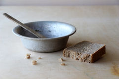 Gruel. Prison gruel, bowl and a loaf of bread Royalty Free Stock Photography