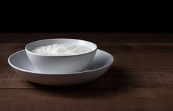 Gruel in white bowl. On wooden background Royalty Free Stock Photography