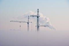 Grues en nuages Image stock