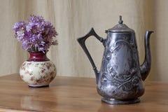 Grugy kettle on table Royalty Free Stock Photos