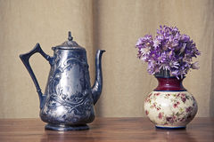 Grugy kettle on table Royalty Free Stock Photography